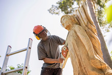 Wood Carver Carving Angel Sculpture, Using Chainsaw
