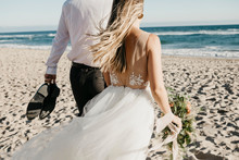 Rear View Of Bride And Groom W...
