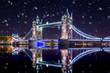 Tower Bridge in London by night ,during a snowstorm