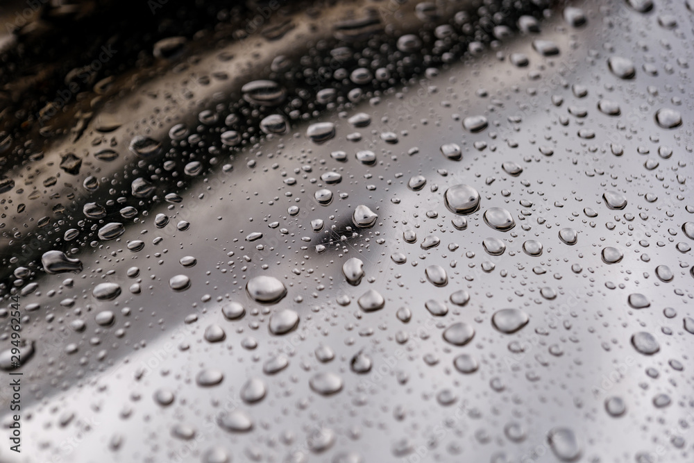 Fototapety, obrazy: Close up and macro view of raining water drops on shiny polished curvature chrome surface of abstract sculpture.