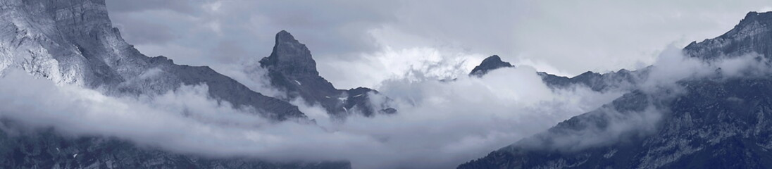 Mountain Peak And Clouds