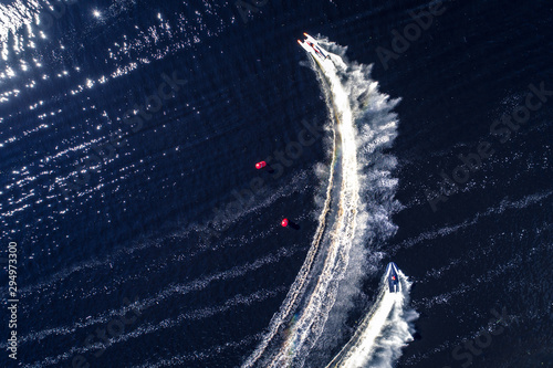 Powerboat racing from above isolated on dark water background.