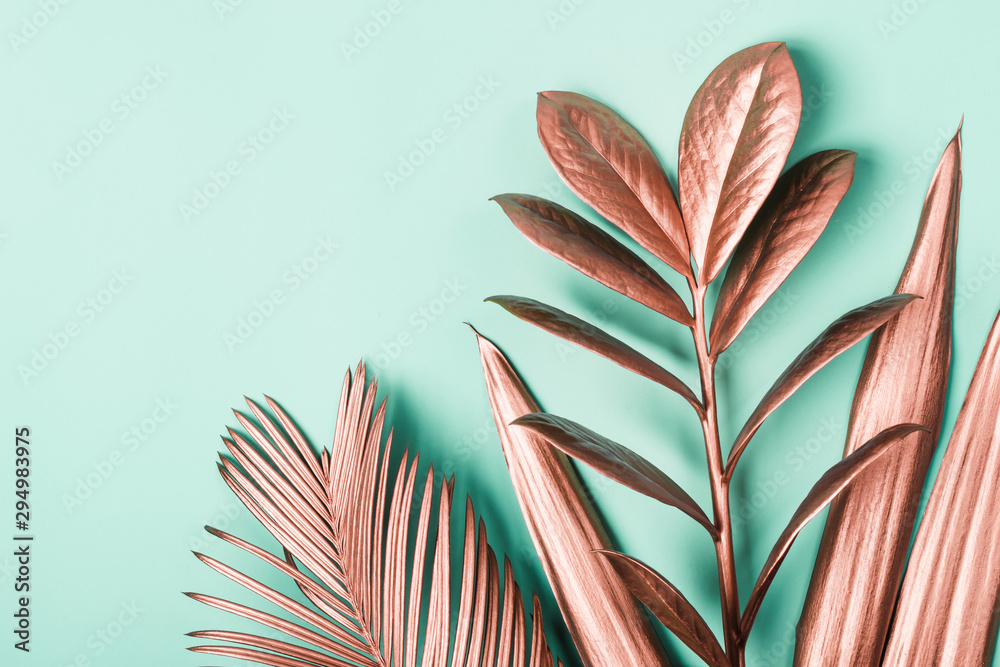 Fototapety, obrazy: Natural Creative layout made of pink metallic tropical leaves. Minimal surrealism background