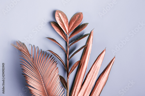 Natural Creative layout made of tropical leaves in pink metallic colors. Minimal surrealism background