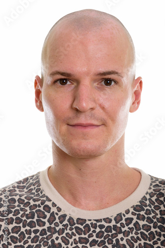 Photo Studio shot of face of young handsome bald man