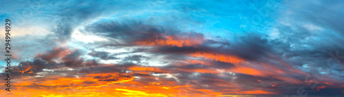 Panorama Sunlight with dramatic sky. Cumulus sunset clouds with sun setting down on dark background.Vivid orange cloud sky. - 294994929