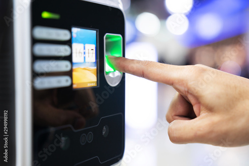 Businessman hand scanning finger on machine,Technology concept, Business concept Wallpaper Mural