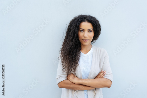 Fototapeta Young woman with folded arms staring at camera obraz