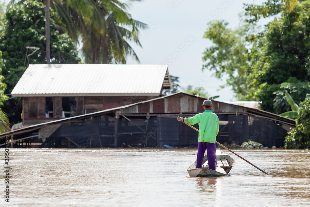 Fototapety, obrazy: Thai man on the boat and looking to his house underwater in flooding situation
