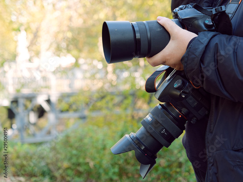 Fototapeta professional photographic equipment in the hands of the photographer obraz na płótnie