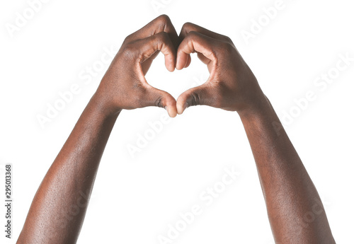 Obraz Hand of African-American man showing heart shape on white background - fototapety do salonu
