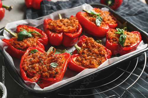 Fototapeta Baking dish with tasty stuffed pepper on table obraz