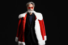 Portrait Of Stylish Santa Claus On Dark Background