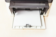 Stack Of White Paper Sheets In Printer Tray