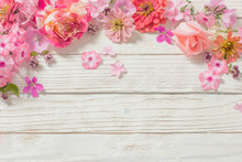 Pink Flowers On White Wooden B...