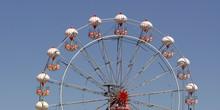 Ferris Wheel On Blue Sky Backg...