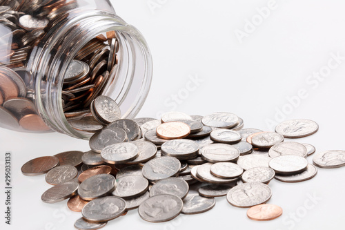 Fototapeta US coins in a jar isolated on white background obraz