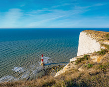 Beachy Head Lighthouse And Cliff In The Morning, Eastbourne, East Sussex, England, UK