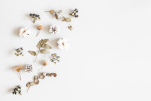 Winter Composition. Dried Leaves, Cotton Flowers, Berries, Pine Cones On Gray Background. Autumn, Fall, Winter Concept. Flat Lay, Top View, Copy Space