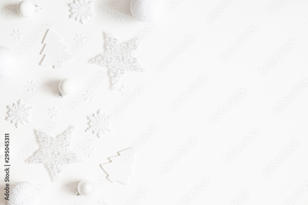 Fototapeta Christmas composition. Frame made of white decorations on white background. Christmas, winter, new year concept. Flat lay, top view, copy space
