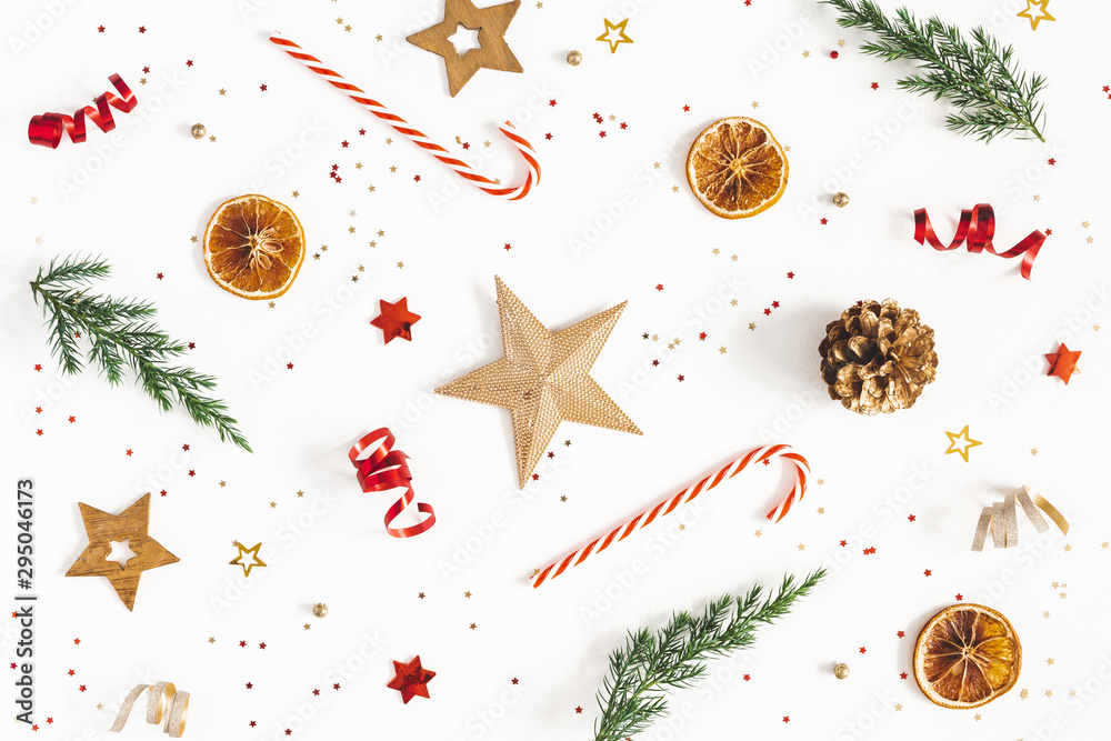 Fototapeta Christmas composition. Fir tree branches, golden and red decorations on white background. Christmas, winter, new year concept. Flat lay, top view