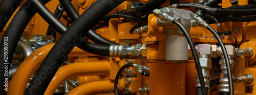 Banner with close up view of hydraulic pipes of heavy industry machine Canvas Print