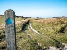 South Downs Way Direction Marker. A Signpost On The 100 Mile Walk Along The South Coast Of England Between Eastbourne And Winchester.