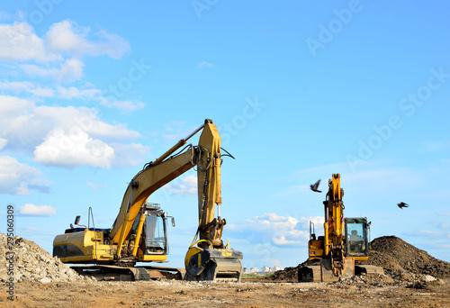 Fotografie, Obraz  Two yellow excavators at a construction site