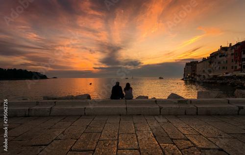 Fotografia  Sunset for two. Sunset in Rovinj. Croatia.