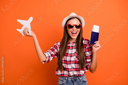 obraz PCV Photo of pretty attractive positive optimistic cheerful glad nice girl waiting to go abroad on plane holding boarding pass in hands isolated bright color background