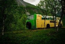 Abandoned Bus / Van In The Middle Of The Forest. Rusted Out Old School Bus Abandoned In The Woods. Taken In Lyngen, Norway