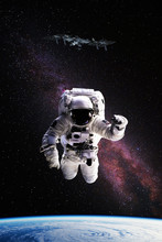 Astronaut In Outer Space Over ...