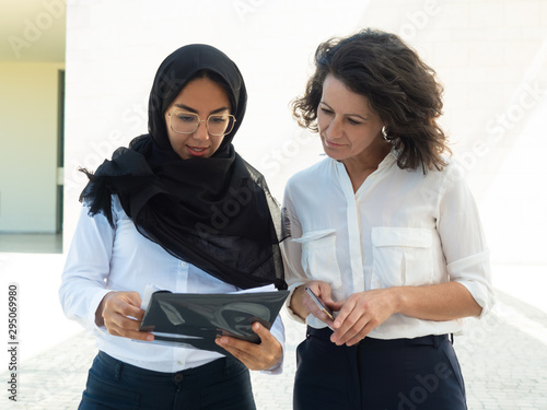 Muslim female professional consulting colleague Wallpaper Mural