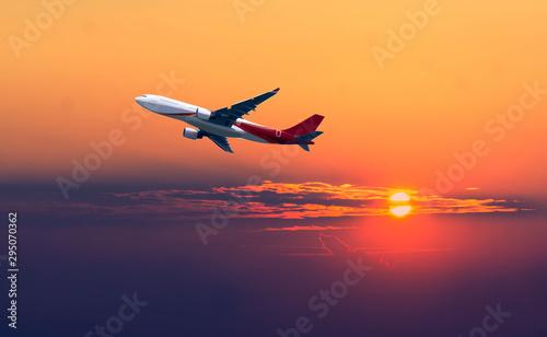 Airplane in the sunset sky flight travel transport airline background concept Billede på lærred