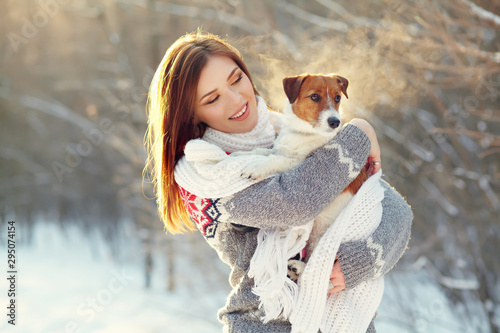 Obraz na plátně  Jack Russell Terrier dog with owner in the winter outdoors