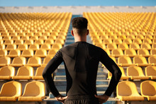 Back View Of African American Sportsman Among Empty Stadium Seats