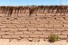Brick Wall From Dry Brown Dirt...