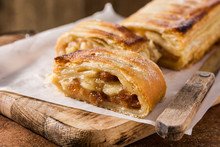 Traditional Homemade Apple Strudel On Brown Background