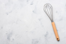 Whisk Cooking Egg Beater Mixer Whisker With Wooden Handle On Table Top View