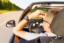 Illness, Exhausted, Disease, Tired For Overworked Concept. Young Man Holds His Hand Over His Head In A Car. Businessman Having Headache From Migraine While He Driving Car.