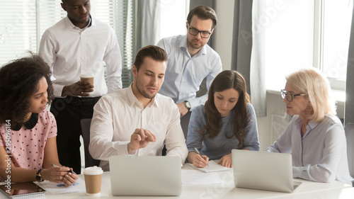 Valokuvatapetti Company employees listening boss sitting at desk in boardroom