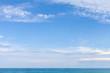 Leinwandbild Motiv Sea water under cloudy blue sky