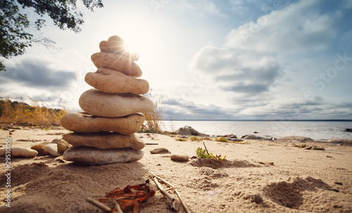 Poster de jardin Zen pierres a sable zen stones stacked at sea with backlight
