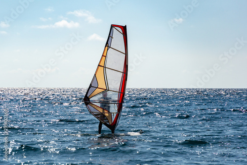 Beautiful view of windsurfer sailing on the waves. Windsurfing on the Black Sea. Yalta, Crimea.