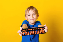Happy Boy Holding Abacus Over ...
