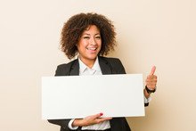 Young African American Woman Holding A Placard Smiling And Raising Thumb Up