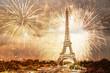 Leinwandbild Motiv romantic New Year destination Eiffel tower with fireworks Paris, France