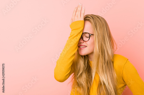 Adorable teenager woman forgetting something, slapping forehead with palm and closing eyes. - 295114375