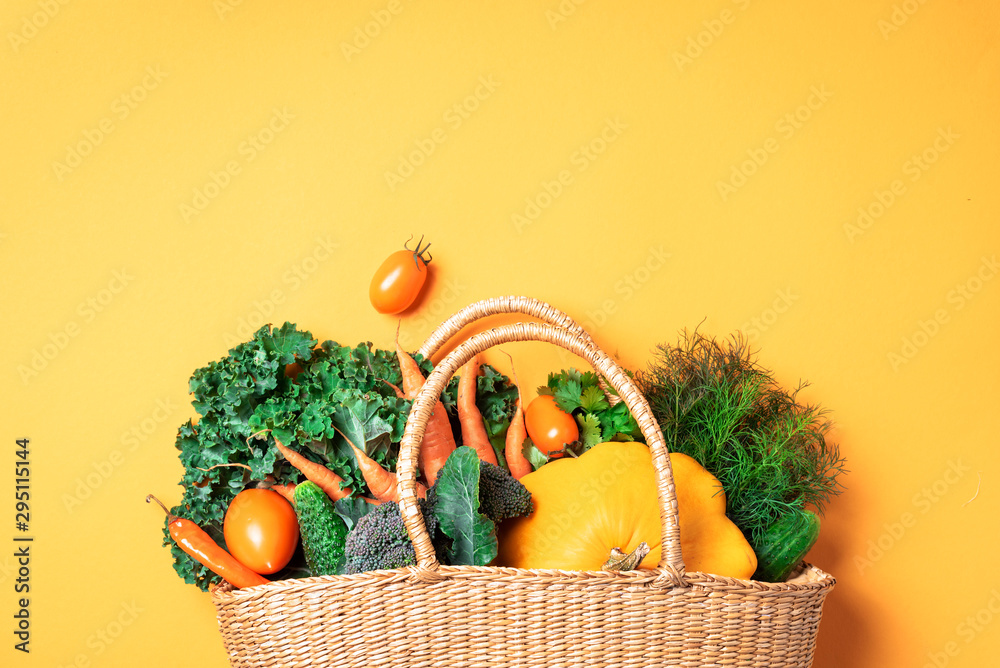 Fototapety, obrazy: Straw basket with organic vegetables over trendy yellow background. Healthy food, vegetarian diet. Eco friendly, zero waste, plastic free concept.