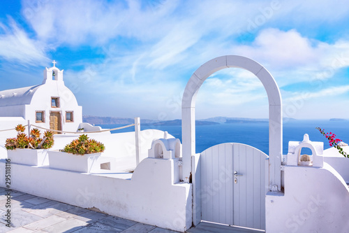 Traditional white architecture and door overlooking the Mediterranean sea in Oia Village on Santorini Island, Greece. Scenic travel background.
